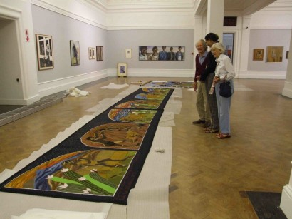 Cecil and Thelma Skotnes looking at First Man Tapestry in the  National Gallery