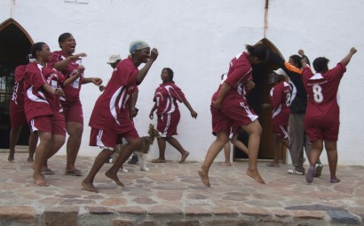 The Centre sponsors a soccer team of young people in the village. Here the artists try out the new kit.