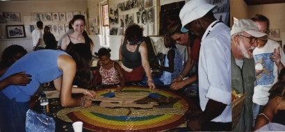 Working on a mosaic with children from the community during a visit from Athol Fugard.